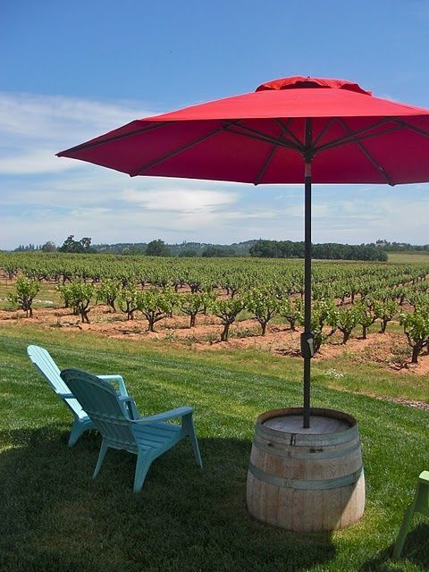 I Love This Distressed Wine Barrel Turned Umbrella Table Stand for Summer Outdoor Living! See More at thefrencinspiredroom.com
