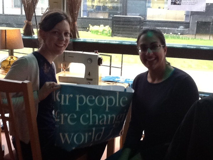 Green Shoppers showing off their lovely designs of  tailor made 'Changing the World for 60 Years' eco-friendly bags.