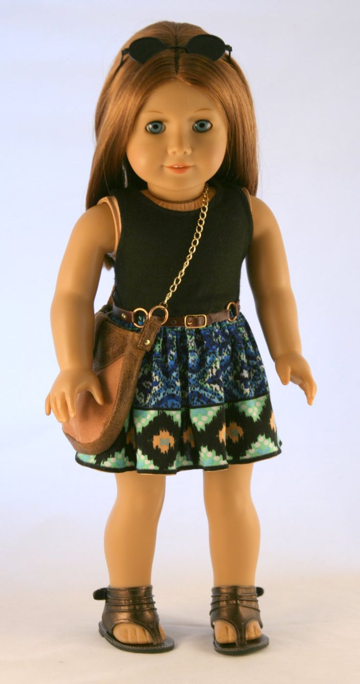 Good way to use up two small pieces of fabric. Looks fabulous. American Girl Doll Clothes - Knit Tribal Print Dress, Faux Leather Purse, and Leather Belt. $39.99, via Etsy.