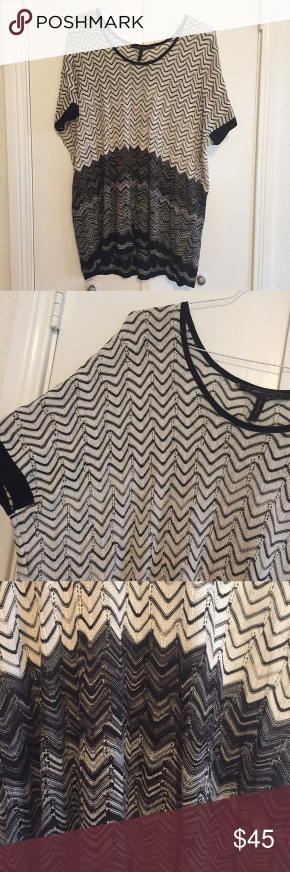 Black and white missoni-like top - one size BCBG Maxazaria Black and white missoni-like top. One size. Very light breathable fabric. I've worn as a swim coverup, a dress, and an oversized top with flares. Very cool and retro. BCBGMaxAzria Tops Tunics