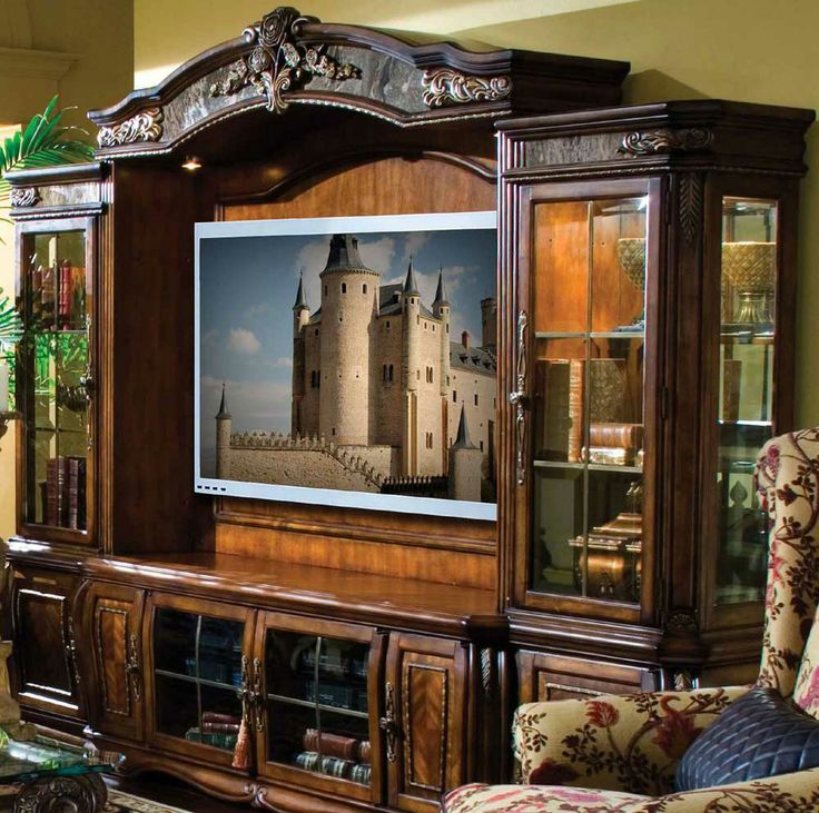 The Oppulente Traditional Sienna Spice Entertainment Unit By Michael Amini  Features Beautiful Lighted Top And Below A TV Stand With Side Speaker  Panels.