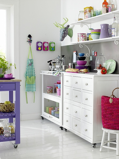 i love everything about this kitchen, no cupboards, love the all white with pops of color...purple chopping block, love it