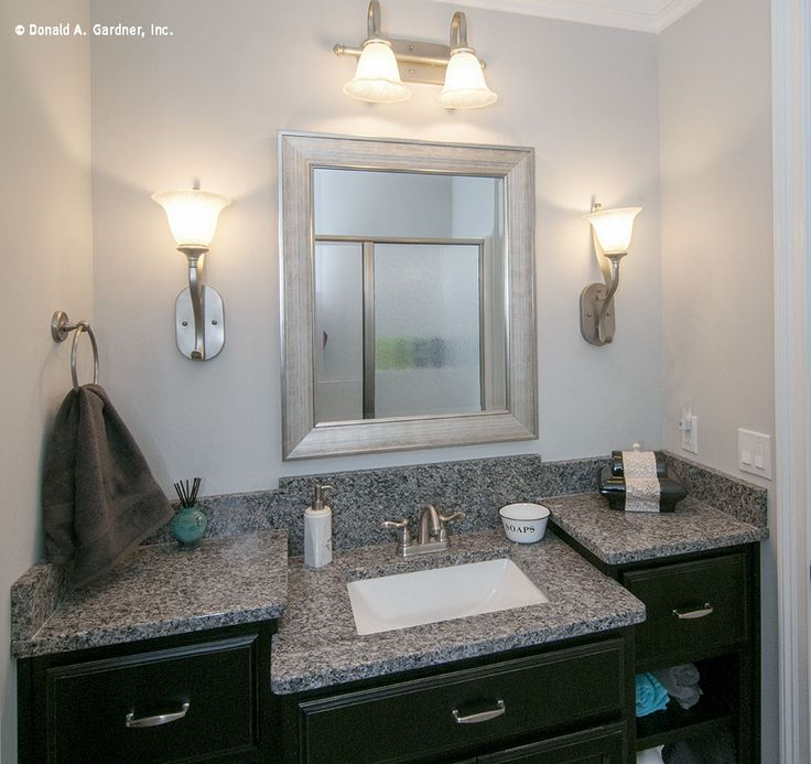 Guest bath with cool gray granite counter tops and silver fixtures.