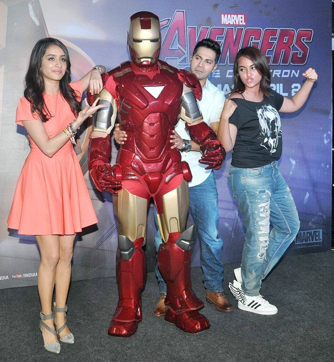 Varun Dhawan and Shraddha Kapoor with Sonakshi Sinha pose next to a man wearing an Iron Man costume at the screening of 'Avengers: Age of Ultron