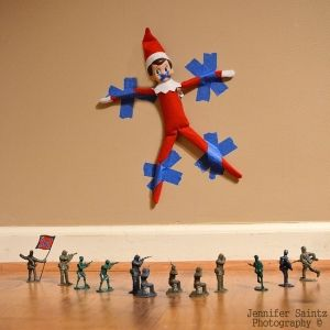 Army soldiers holding an elf captive.  Love this idea for a troublemaker elf!  #elfontheshelf