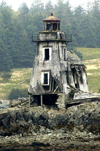 The abandoned Grand Harbour Lighthouse is located at Fish Fluke Point, Grand Manan, New Brunswick, Canada