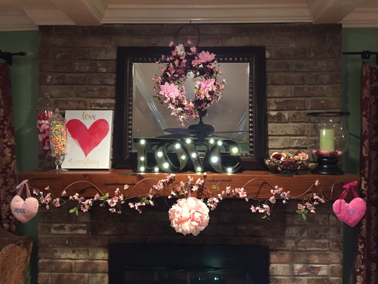 """Valentine's Day Mantle Home Decor- """"love"""" marquee from Michaels, potpourri Asian Poppy from World Market, wreath and garland made from Dollar Tree supplies, apothecary jars filled with candy hearts and pink/red/white Pom Pom pack from Dollar Tree"""