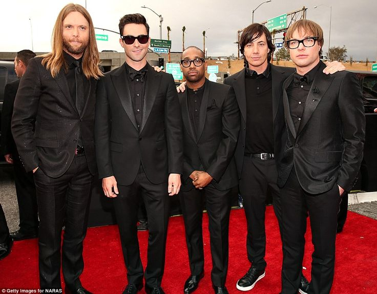 Maroon 5 in matching black suits and shirts.