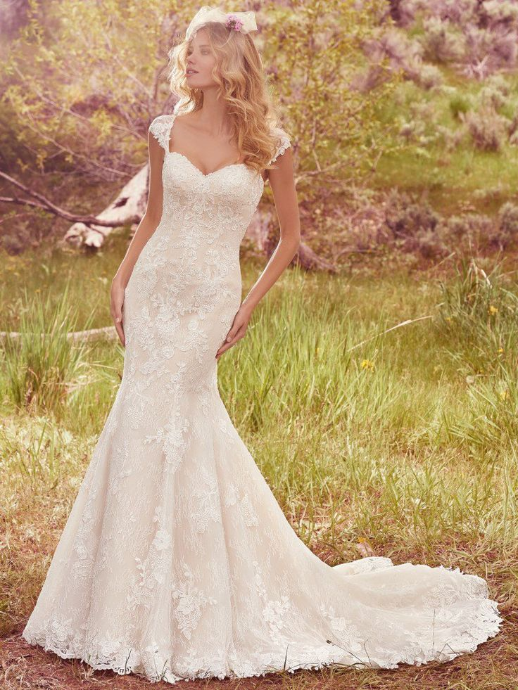 Maggie Sottero Bridal style# 7MS355. This romantic fit-and-flare features lace floral appliqués and a strapless sweetheart neckline, complete with exquisite lace hem and delicate beading. Available at Bridal Collections Spokane, WA