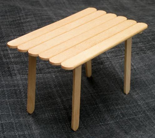 Doll house table with popsicle sticks - a 4-year-old I know could do this!
