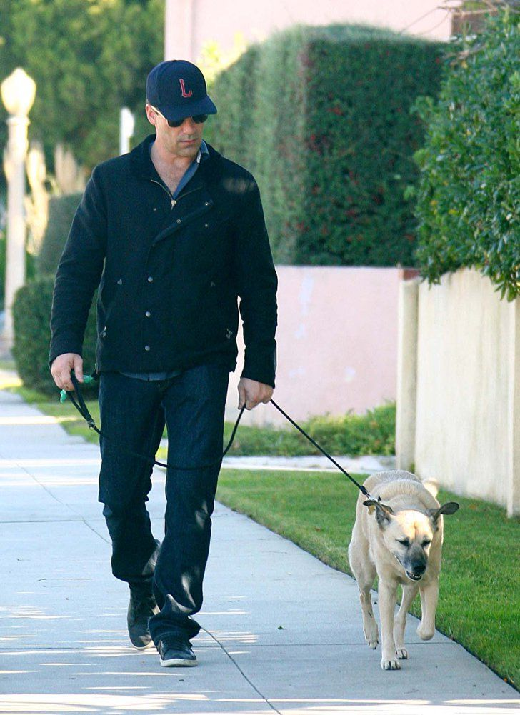 Pin for Later: Hot Hollywood Guys Are Even Hotter When Paired With Pups  Jon Hamm took his dog for a neighborhood walk in LA in December 2011.