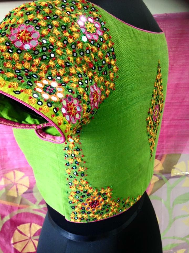 Mirrors on green blouse
