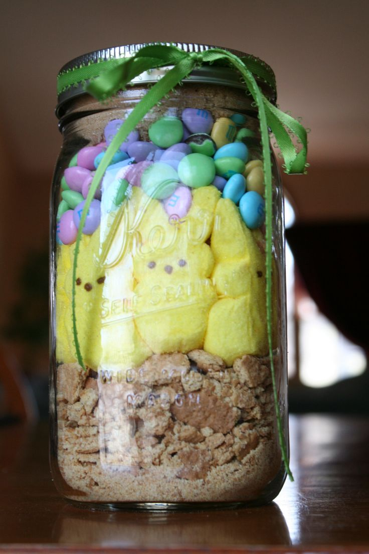 This makes an adorable hostess or springtime gift for a teacher.  They're adorable, and very easy!  1. Take one sleeve of graham crackers and crush to make crumbs  2. Layer 1/2 – 2/3 of the crumbs in a 1 quart Ball jar  3. Place 8 marshmallow bunny peeps standing up, facing out around the inside of the jar  4. Press them up against the glass, but don't squash them  5. Carefully spoon remaining crumbs in the center of the jar to support the bunnies, pressing down to keep them secure  6. On…