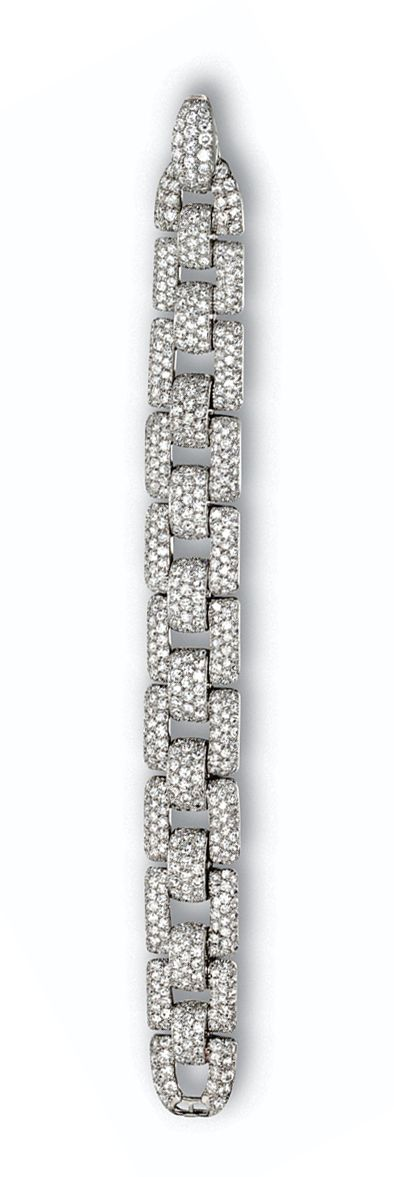 DIAMOND BRACELET, CARTIER, PARIS, CIRCA 1935.  Composed of square-shaped links pavé-set with 655 single-cut and round cut diamonds weighing approximately 18.50 carats, mounted in platinum, length 6 5/8 inches, signed Cartier, Paris, indistinct serial number, assay marks.