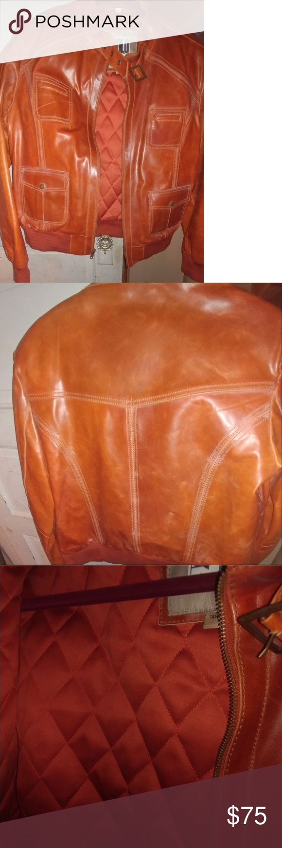 Women's Cognac Leather Bomber Jacket Size 3XL Genuine Leather Hipster Jacket Quilted Liner 4 front pockets (2 top 2 bottom) Size 3XL...cut small  Color burnt orange Gently worn...no tears,stains or discoloration solo Jackets & Coats