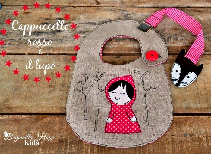 I've created a bib that tells the story of Little red riding hood and the wolf. The pacifier clip has the wolf at one end.
