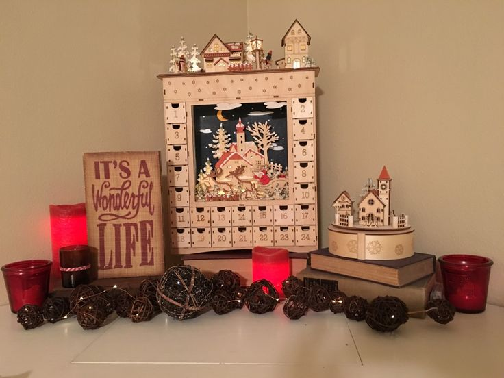 Beautiful Scandinavian advent calender and music box found at Tickled Pink. Along with the wicker balls, copper lights, red Merry Christmas candle jars, It's a wonderful life sign and Thymes ginger bread candle. Tickled Pink has it all <3