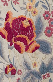 Chinese hand-embroidered silk shawl, c.1900-1920. Exquisitely hand embroidered with large bouquets of flowers in each corner. The high relief satin-stitch embroidery showcases the soft muted shades that are the gift of Time to Art