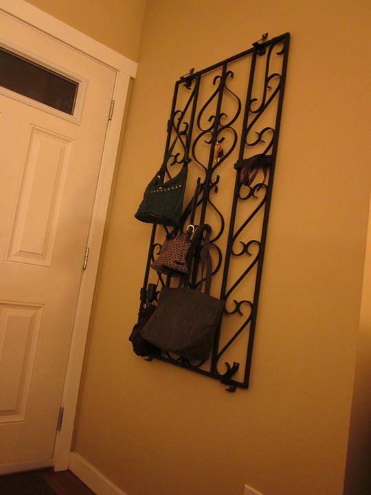 A clever use for an old wrought iron gate. I used brackets and s hooks for hardware. Wa-La front door coat rack!
