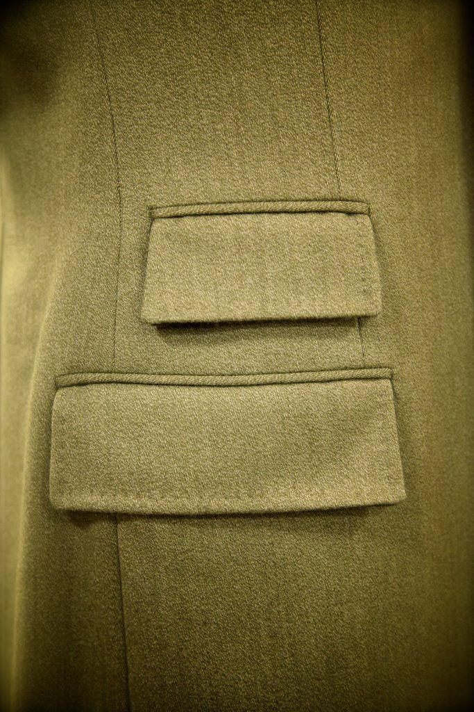 This traditional Covert Coat features contrasting velvet on the inside of the pocket flaps.