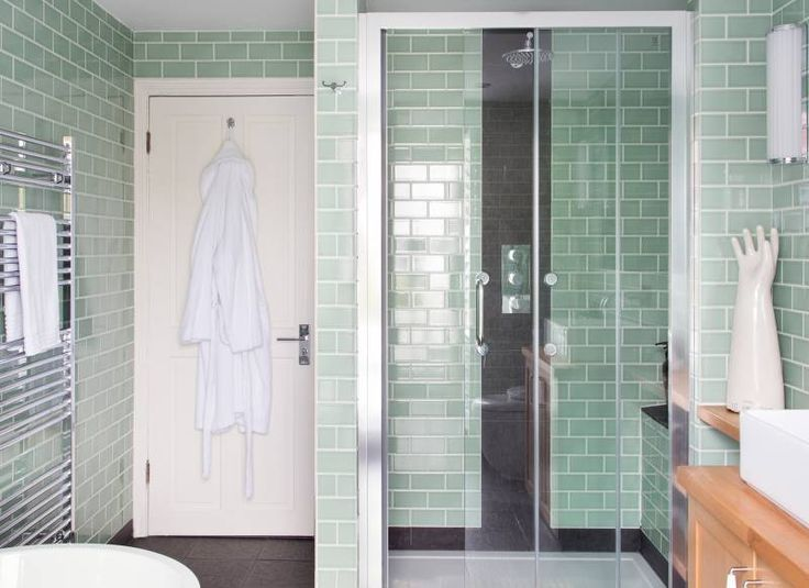 Create a New York-style loft vibe in your bathroom by tiling your walls from floor-to-ceiling with metro tiles. Choose a colour that will stand the test of time, is gender-neutral and will perfectly match your existing fittings. Draw attention to the shower with a strip of contrasting black tiles behind the shower fittings and around the shower tray to create a tiled skirting that defines the space. Read more at http://www.theroomedit.com