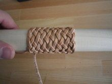 I know it's not paracord but you could use this pattern. Living to the craftsman - J's Leather Blog -