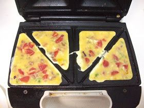 My sister told me about this little trick this past summer for making omelets. Now, I wouldn't go out and buy a sandwich maker just to make ...