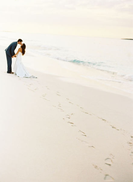 this is cute...i think we shld bring some type of rake/broom to clear the sand of footprints for pics