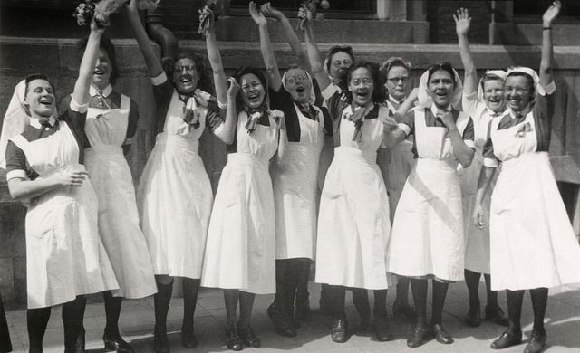 Dutch Nurses waving at Canadian liberators, WW II 1945