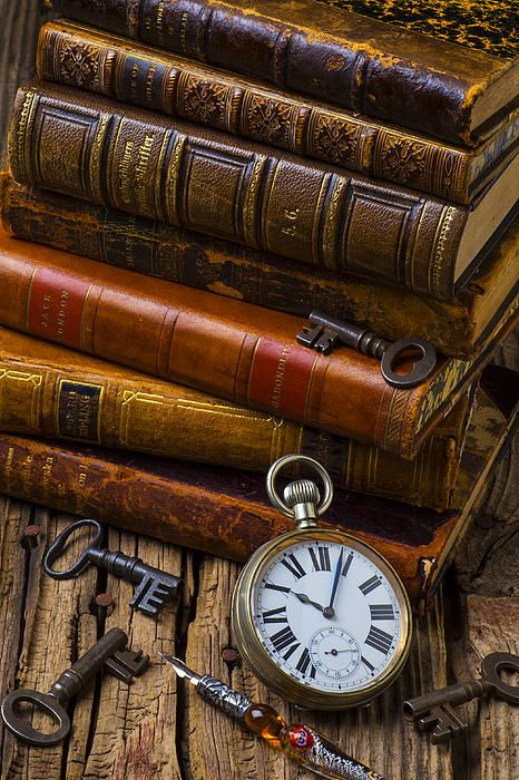 Beautiful old books, keys and pocketwatch. :)
