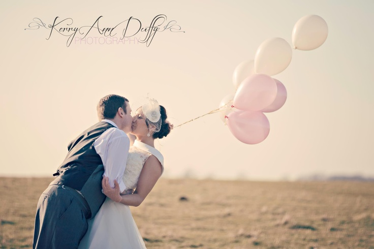 www.kerryannduffy.com  bride and groom in the middle of a field with balloons.