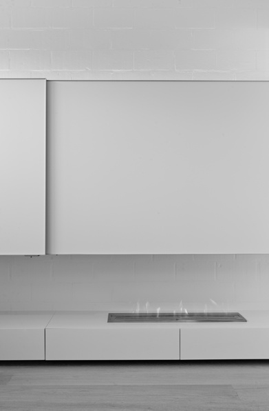All white interior with a minimal fireplace by Filip deslee _