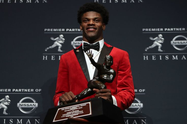 Lamar Jackson Photos Photos - Lamar Jackson of the Louisville Cardinals poses for a photo after being named the 82nd Heisman Memorial Trophy Award winner during the 2016 Heisman Trophy Presentation at the Marriott Marquis on December 10, 2016 in New York City. - Heisman Ceremony