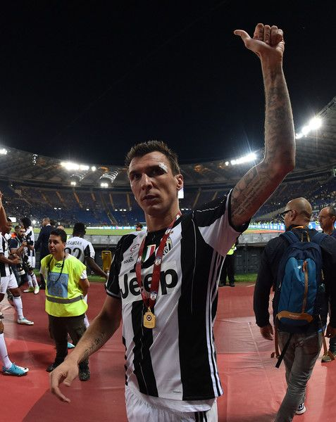 Mario Mandzukic of Juventus FC celebrates the victory after the TIM Cup Final match between SS Lazio and Juventus FC at Olimpico Stadium on May 17, 2017 in Rome, Italy.