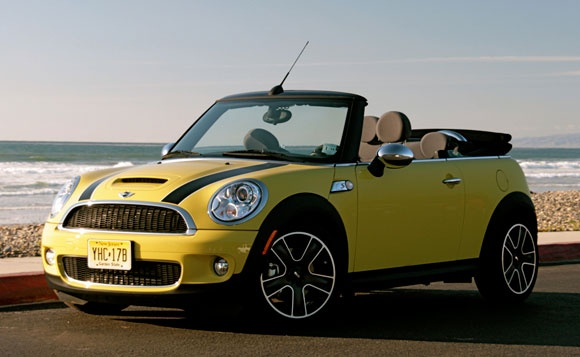 Mini Cooper S convertible. Love yellow cars