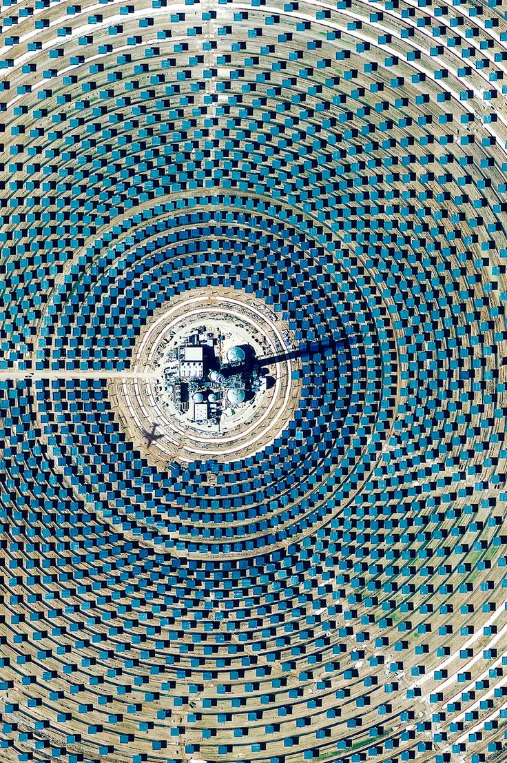 11MW PS10 solar power plant outside of Seville, Spain. World's first commercial concentrating solar tower gathers sunlight from 624 heliostat mirrors.