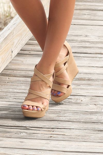 Neutral colored wedges featuring a 5 inch heel with criss-cross straps, footwear