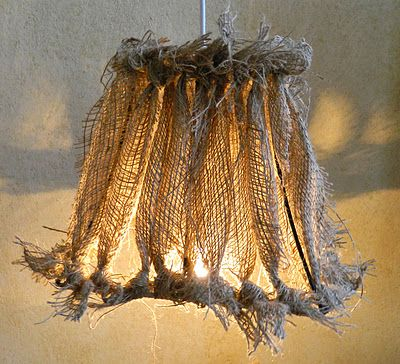 Shabby Chic...burlap lamp shade...strips of burlap tied onto the wire edges of a shade...