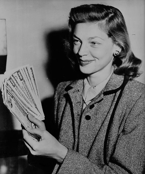 Lauren Bacall picked up her $2300 in bonds at the Los Angeles Civic Center. The bonds represented approximately ten per cent of her film earnings while she was working as a minor, under a routine court order. March 24, 1948