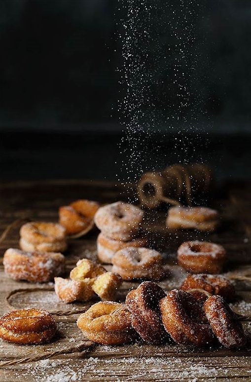 anise donuts. | @ANDWHATELSEISTHERE This is a very tasty picture. The composition is great since our focus stay in the white area where the focal point is. The powders direct our eyes to donuts at the bottom. All at all the whole composition is compelling.