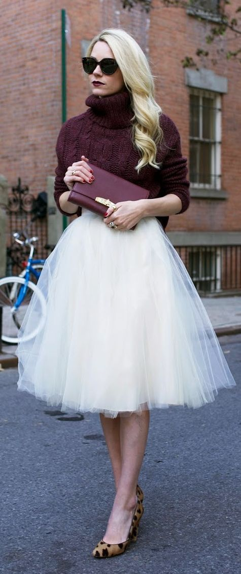 Love this deep red sweater with the crisp white tutu. Hello city chic