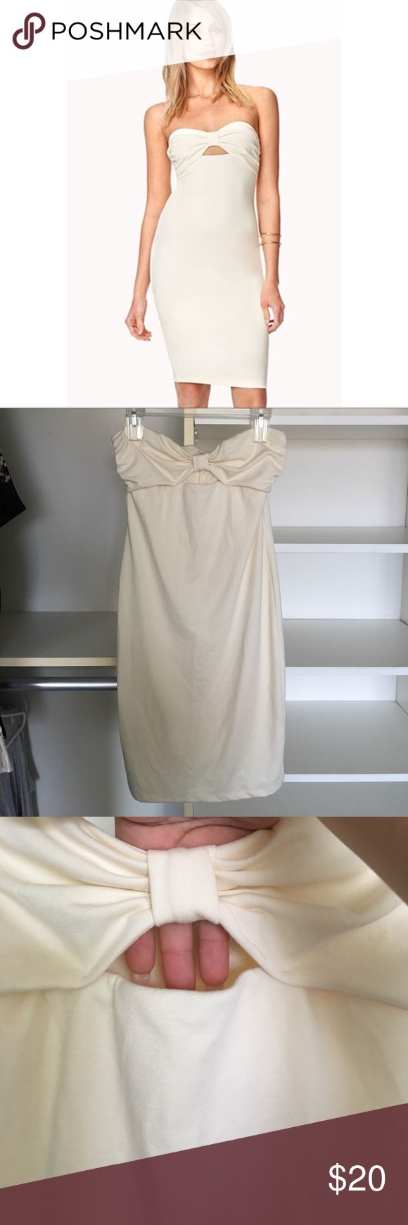 Forever 21 cream bow strapless bodycon dress Worn 1x! In excellent condition. Very sexy, bodycon dress. Peek a boo keyhole in front. Perfect for any occasion. Dress up or down. Needs a new home ❤️ Forever 21 Dresses Strapless