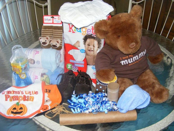 Someones getting the BIGGEST treat for Halloween.. A BABY BOY...I made  a diaper bike for their shower... Items needed... 2 bibs, 2 pkgs. of 40, . Sz.3, =18 to…