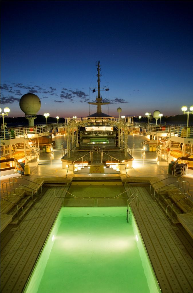 Order a #drink on the Hera #deck, beside the Louis Olympia's sparkling #pool, and watch the #Aegean unfurl before her. #cruiseship #cruising #onboard #travel #vacation #summer