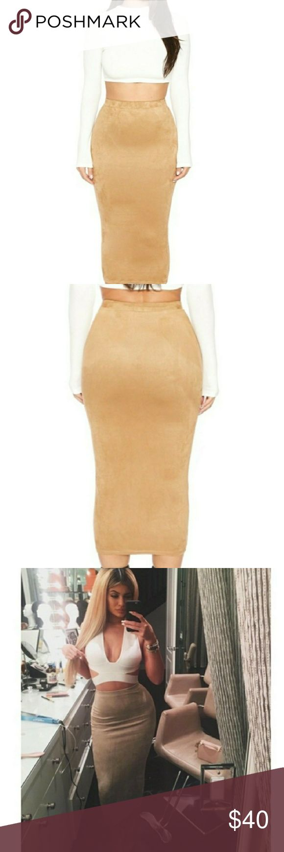 Naked wardrobe suede skirt This adorable faux suede midi skirt is perfect for a night out or casual day shopping! Naked wardrobe is carried in the Kardashian stores Dash and is seen here worn by Kylie Jenner. This skirt is a medium, but is most definitely true to a size small. Sold out in the website!!!! naked wardrobe Skirts Midi