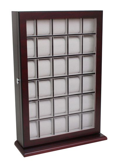 - Tastefully protects, stores, and organizes up to 30 watches - Hang on the wall or use as a stand with included base piece - Eliminates clutter and keeps watches protected and scratch-free - Elegant