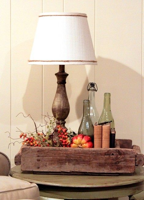 Upcycle a few wine bottles and have a place to store your book.