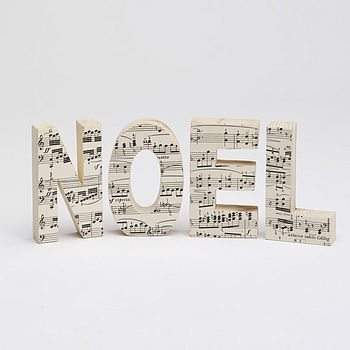 NOEL @ http://www.notonthehighstreet.com/bombus/product/vintage-music-letters