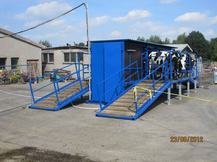 Europe dairy systems mobile milking parlour laurel for Dairy barn plans