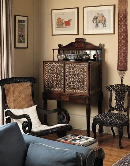 Ismail Merchant Collections, From left to right A Ceylonese Solid Ebony Easy Armchair, circa 1850 An Indian Ivory-Inlaid Ebony and Rosewood Cabinet-on-Stand, the Cabinet Gujarat or Sindh, Late 17th / Early 18th Century, the Stand English, 19th Century Two Watercolour Drawings from the celebrated Fraser Album, circa 1815-1819 An Indian Blackwood Side Chair, Bombay, circa 1860